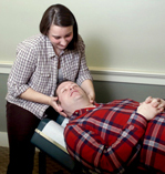 photo of the doctor working on a male who is lying on his back
